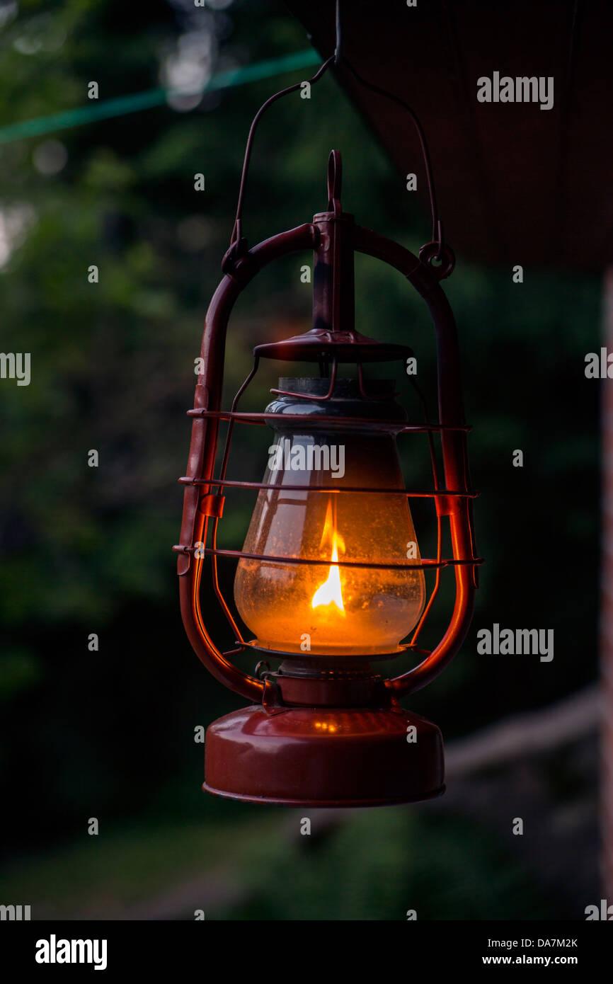 Old fashioned latern burning flame thanks kerosene fuel - Stock Image