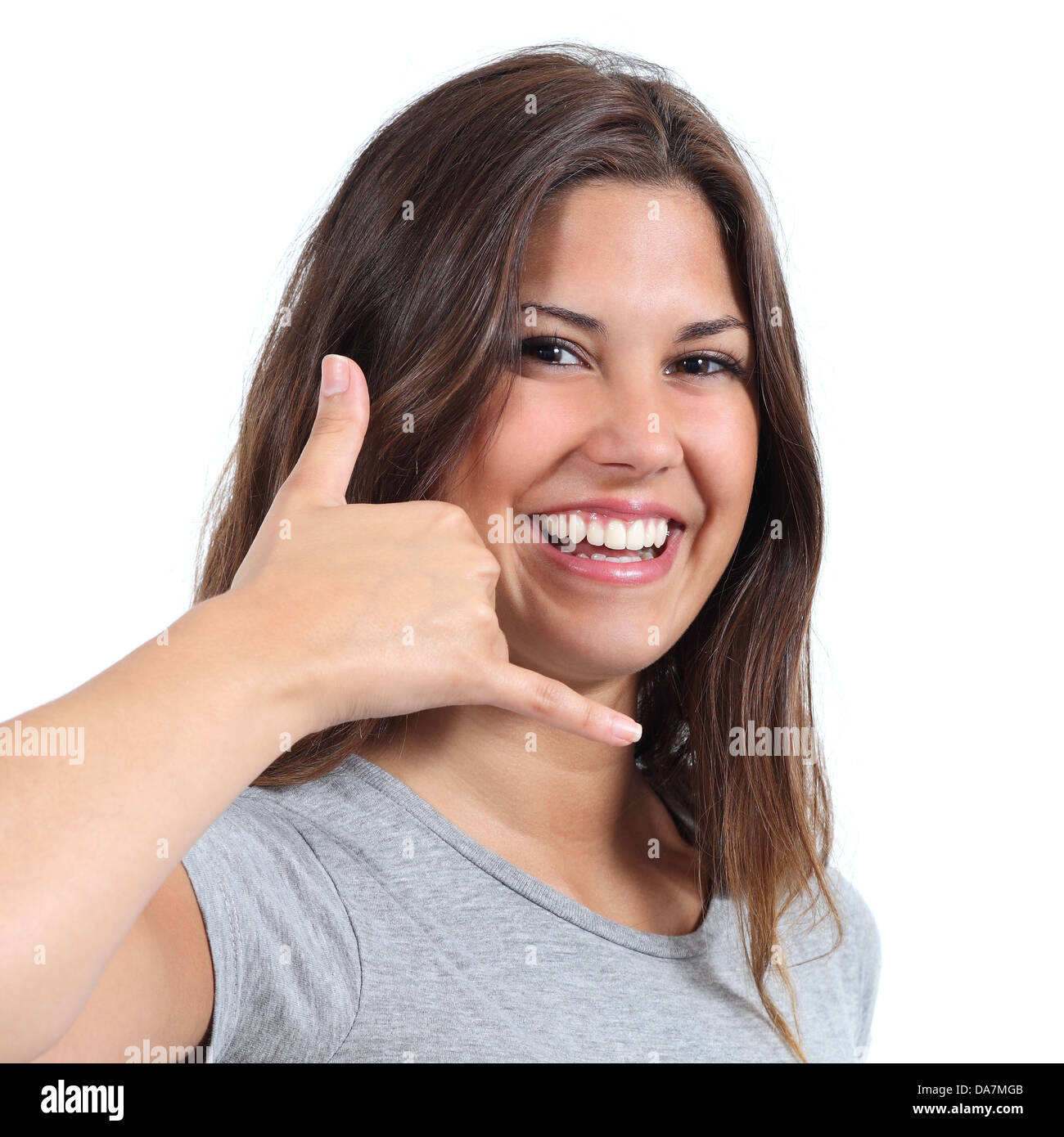 Attractive teenager girl making call me gesture with her hand isolated on a white background - Stock Image
