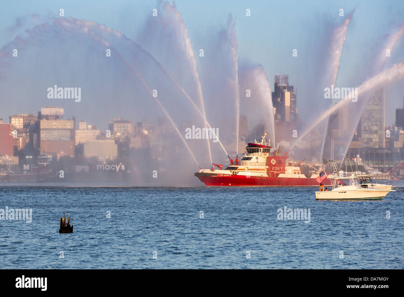 Fire Fighter fireboat parading on Hudson River - 4th of July, 2013 - Stock Image