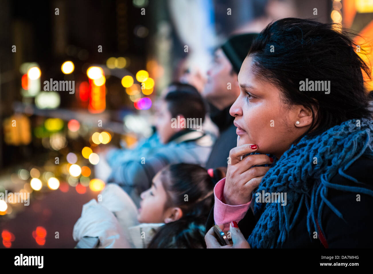 Profile Portrait of a Times Square tourist with the city lights in the background - Stock Image