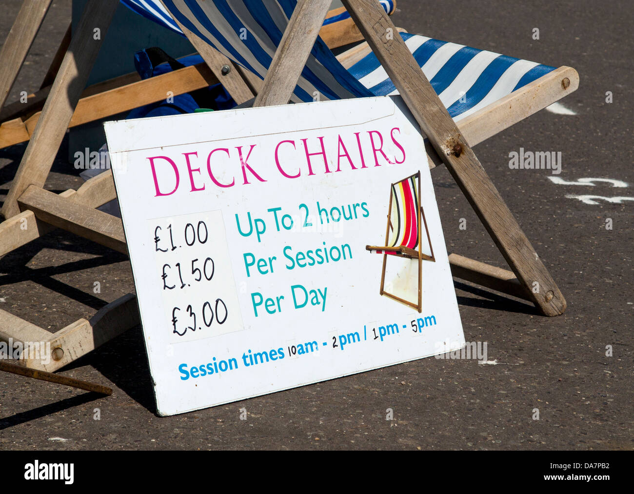 Deck chair hire sign in Sidmouth, Devon, England - Stock Image
