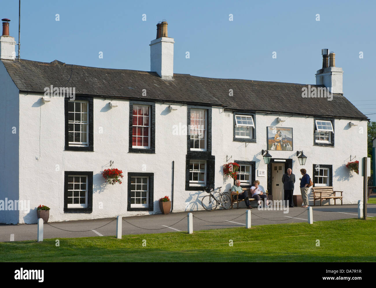 Locals enjoying a drink outside the Shepherds Inn, in the village of Langwathy, Eden Valley, Cumbria, England UK - Stock Image