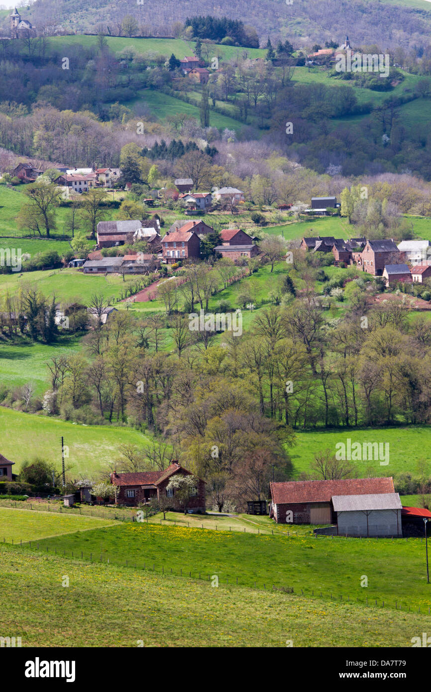 Bucolic scenic landscape with hilly pastures and farmhouses in Midi-Pyrenees region of France - Stock Image