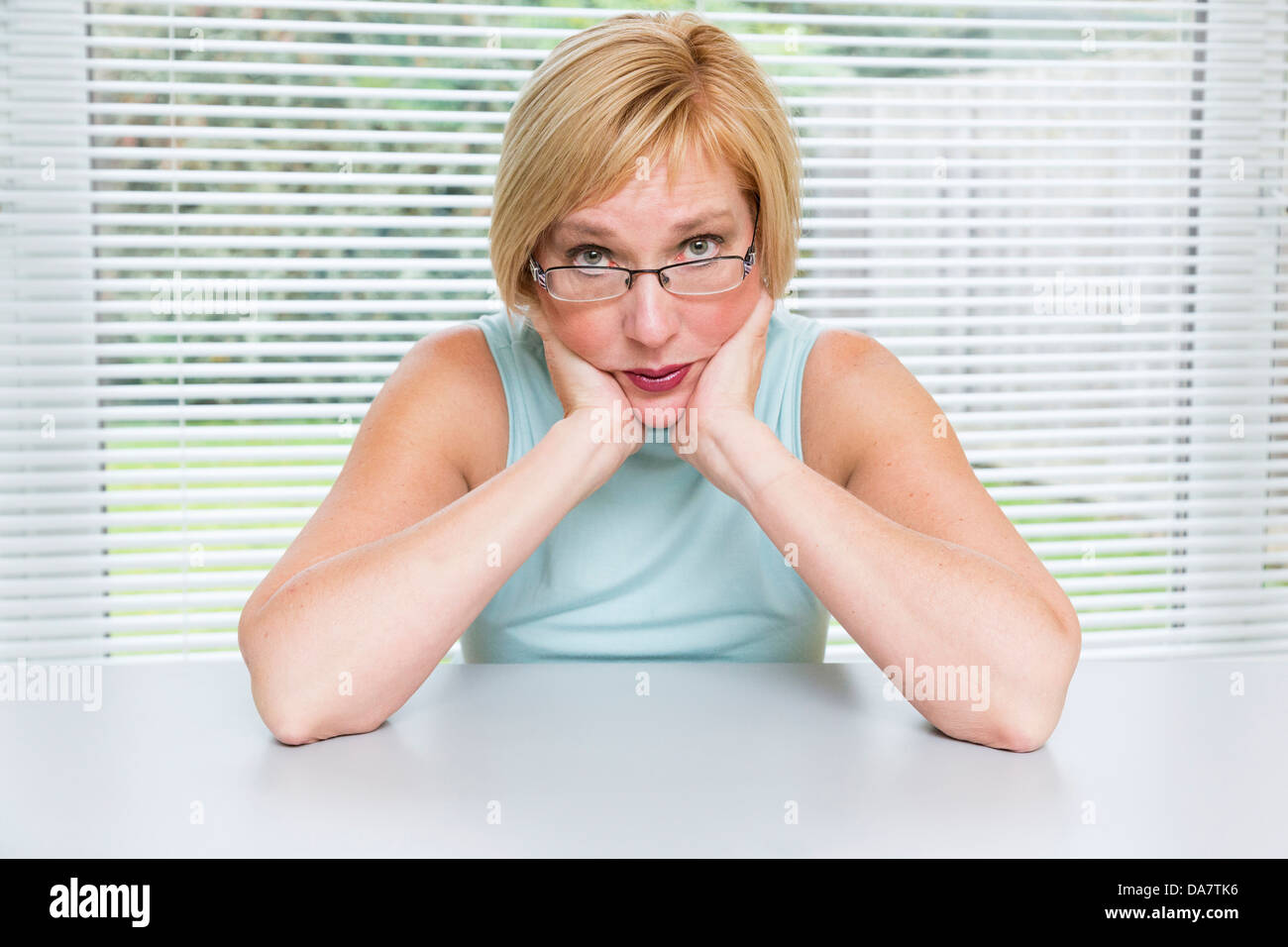 woman looking worried and concerned - Stock Image