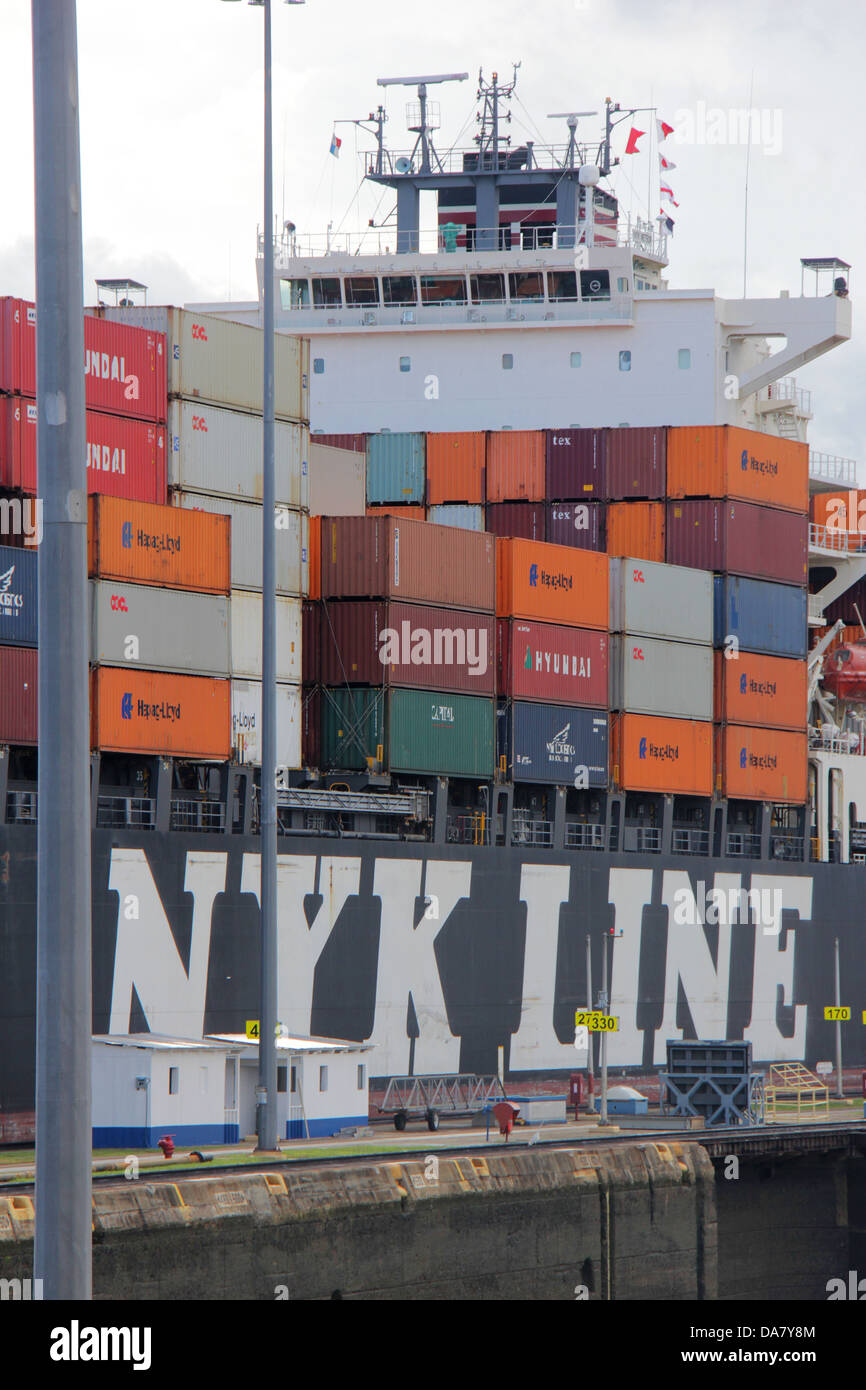 NYK Line ship in the Panama Canal with containers stacked on deck. - Stock Image