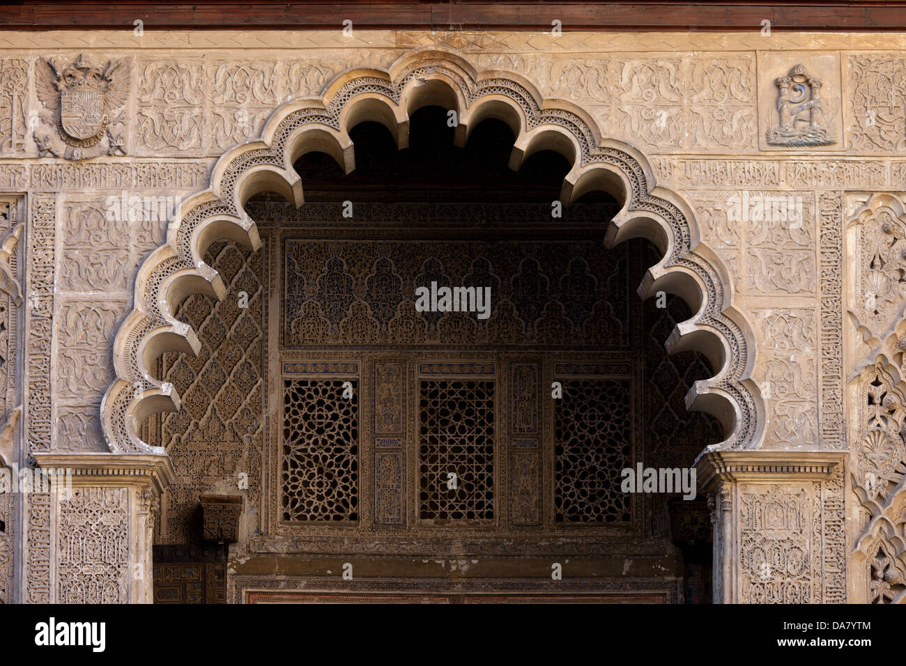 Mudejar style arch in the Patio de las Doncellas (Courtyard of the Maidens), Alcazar Palace of Seville, Andalusia, Stock Photo