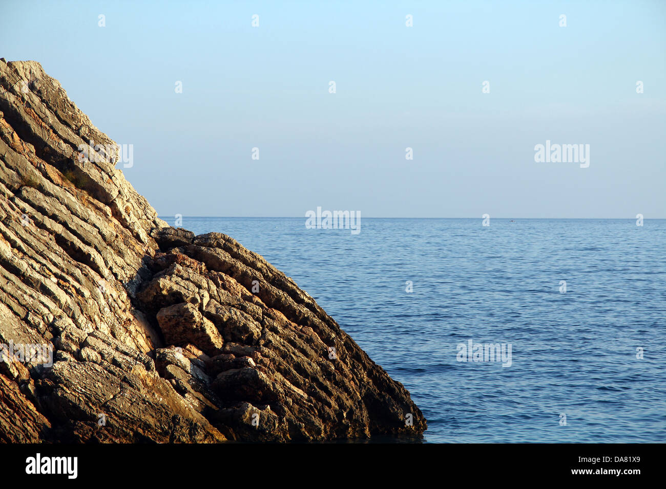 Old cliff on the coast of Adriatic see in Montenegro. - Stock Image