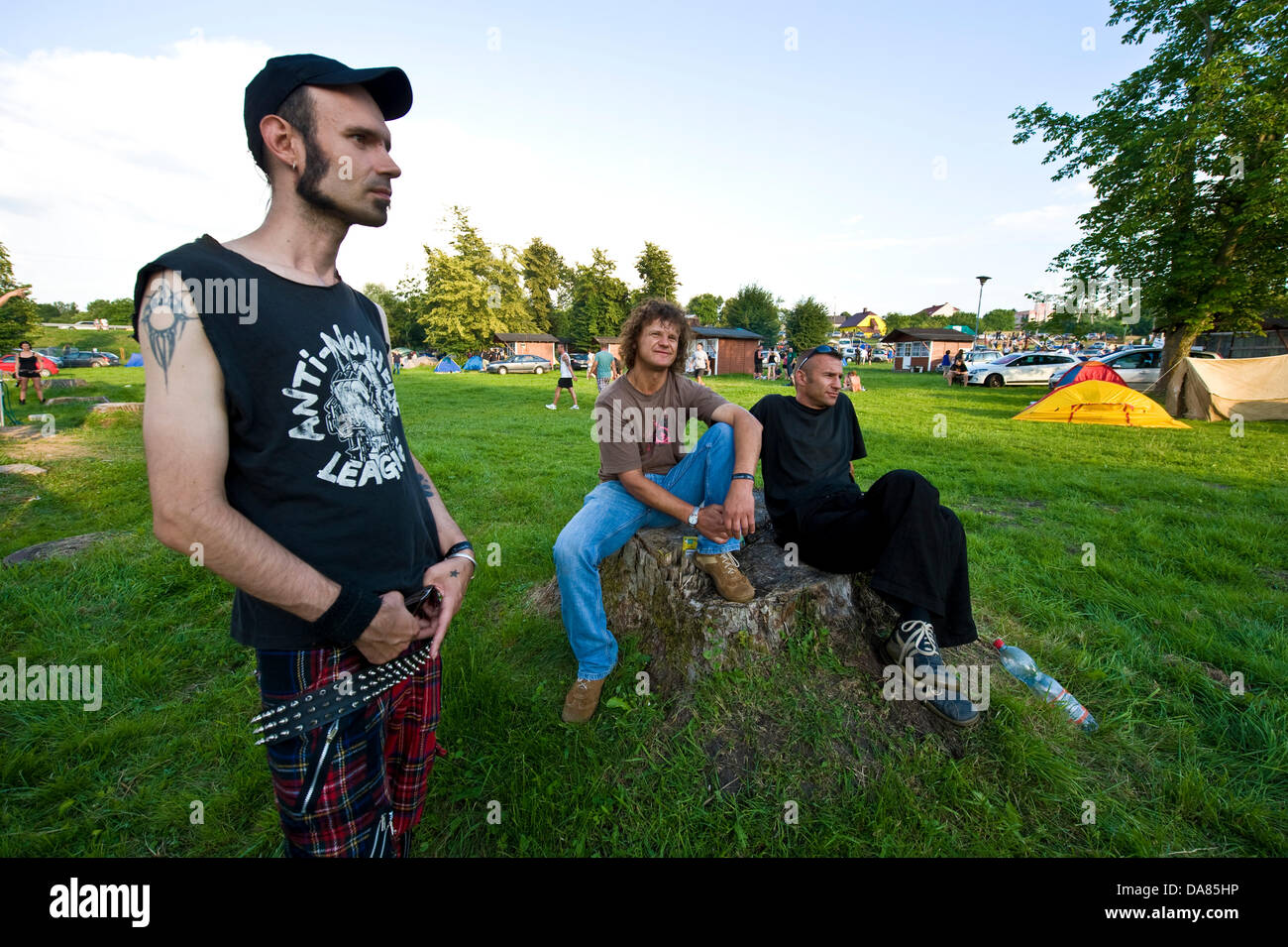 Goniadz, Poland - July 7th, 2013 - A two-day event called The Swamp Rock Fest (Rock na bagnie) arranged in the middle of wetlands in North-Eastern Poland attracted tens of punk rock groups and hundreds of their devotees. This working-class subculture, orignating from the 1970s, is gaining ground in certain countries due to high unemployment figures. Stock Photo