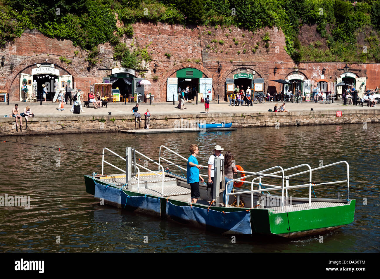 People crossing the river Exe on a ferry at The Quay, Exeter, Devon, UK. - Stock Image