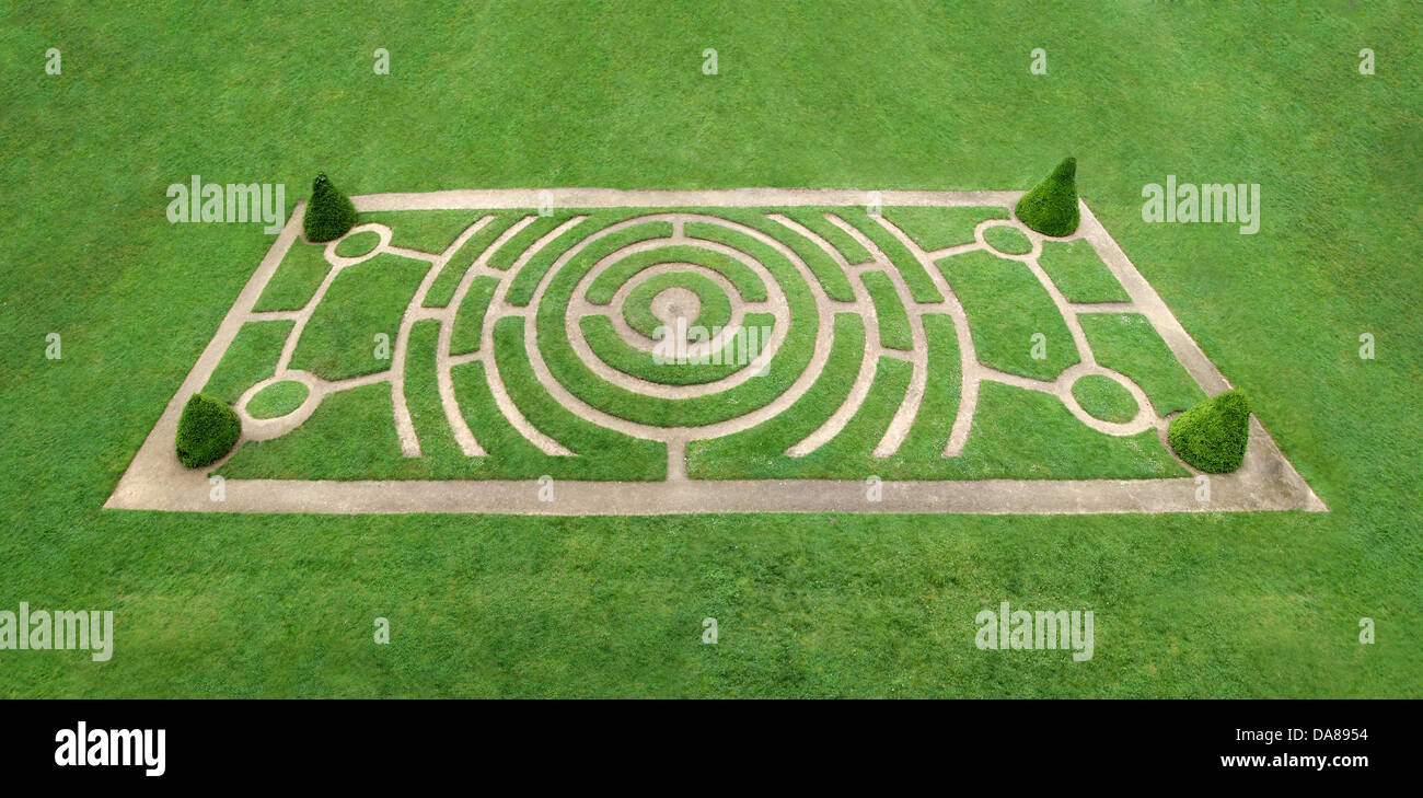 Circular labyrinth as a walking trail in the grass - Stock Image