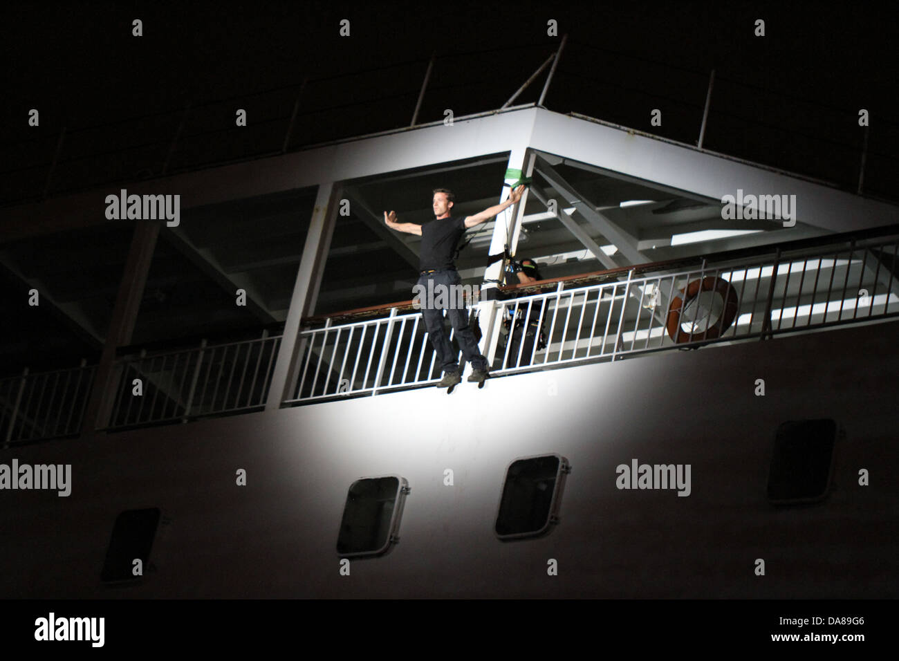 Man walking down the side of a cruise ship - Stock Image