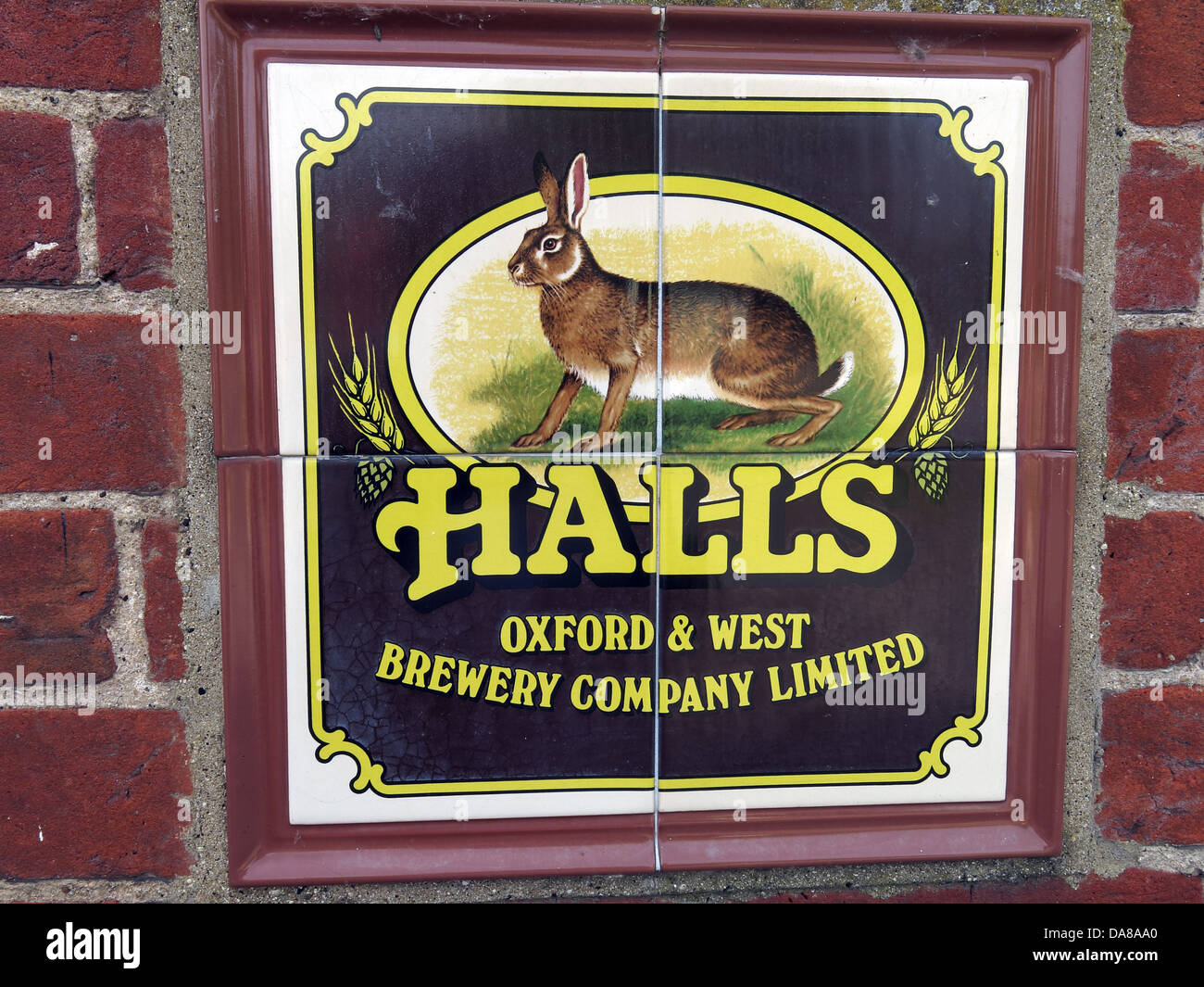 Halls Oxford & west Brewery Co Ltd Tiled Sign on an old pub exterior, now a house in High st, Dorchester on - Stock Image