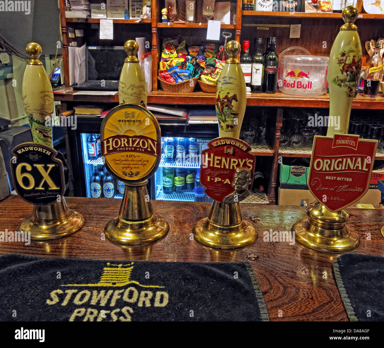 English traditional ale hand drawn pumps on a bar in Wiltshire, South West England Stock Photo