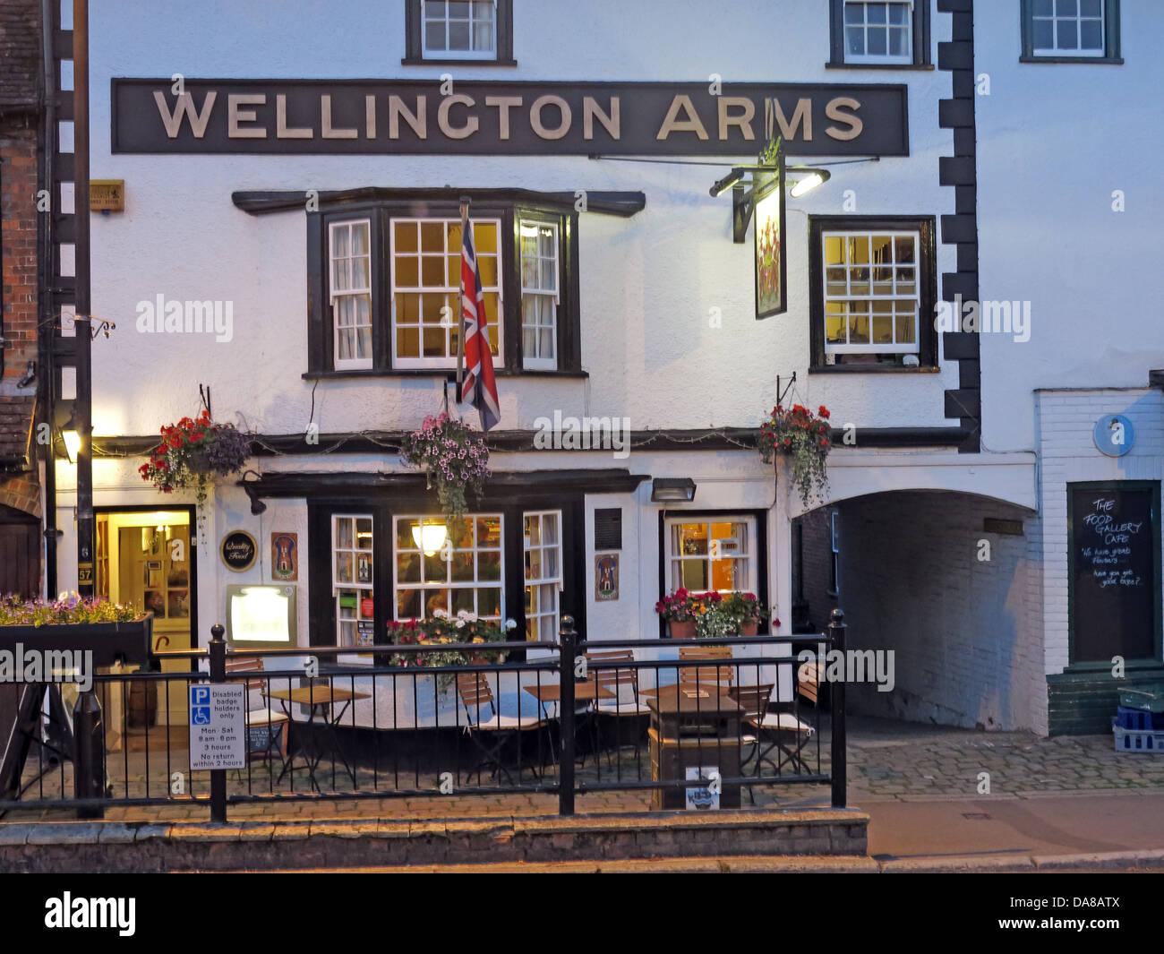 The Wellington Arms, 46 High St, Marlborough SN8 1HQ  at dusk - Stock Image
