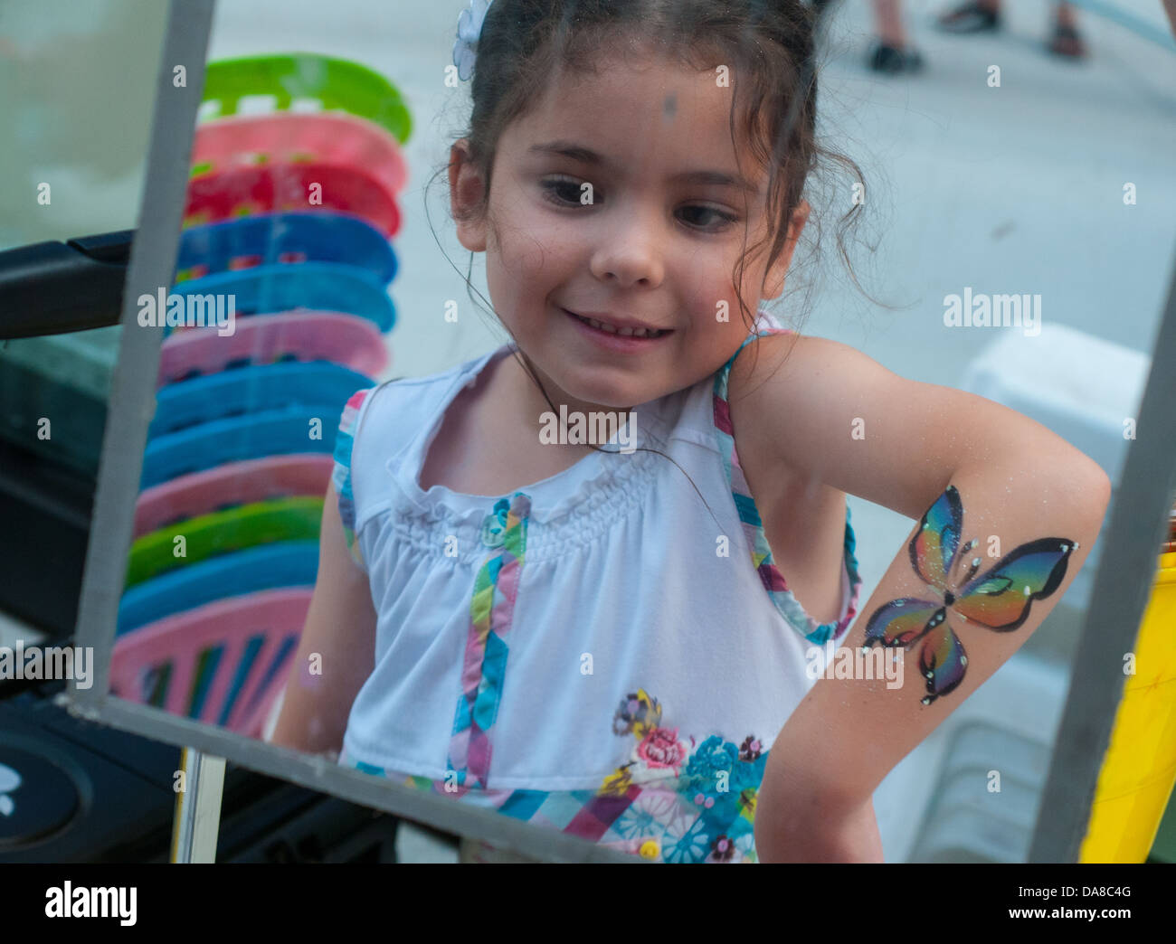 Children's artistic free make-up at Montreal Jazz Festival, Montreal Canada, July 2013 - Stock Image