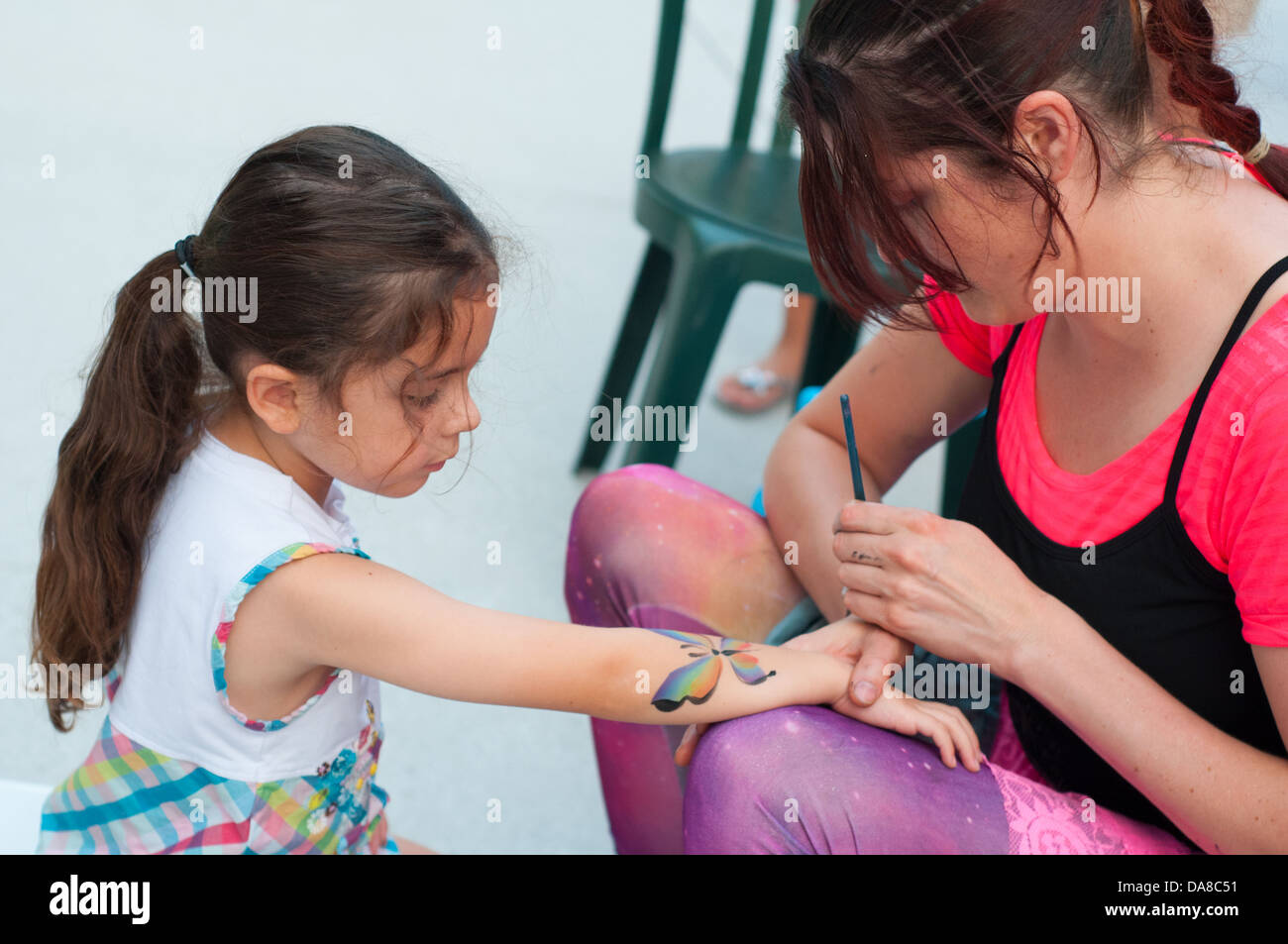 Children's artistic free make-up at Montreal Jazz Festival, Montreal Canada, July 2013 - Child is model released - Stock Image