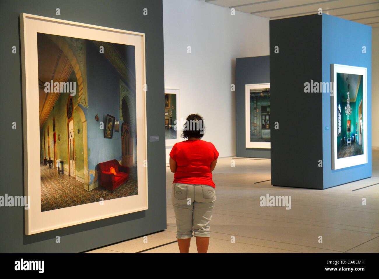 Tampa Florida Tampa Museum of Art gallery inside looking appreciating Hispanic woman photographs - Stock Image