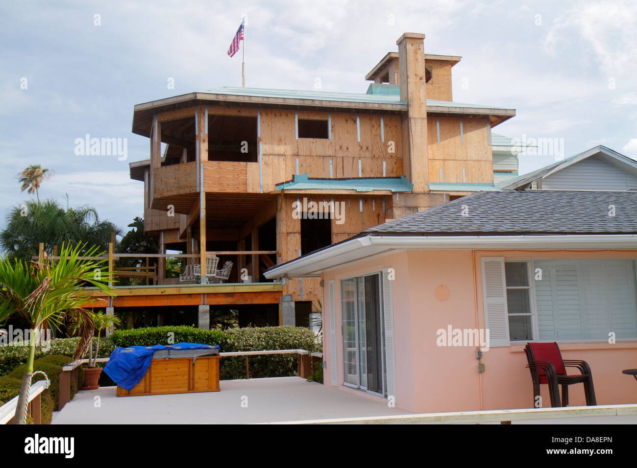 Florida Clearwater Beach new home construction waterfront 2 two story storey 1 one story blocking view neighboring - Stock Image