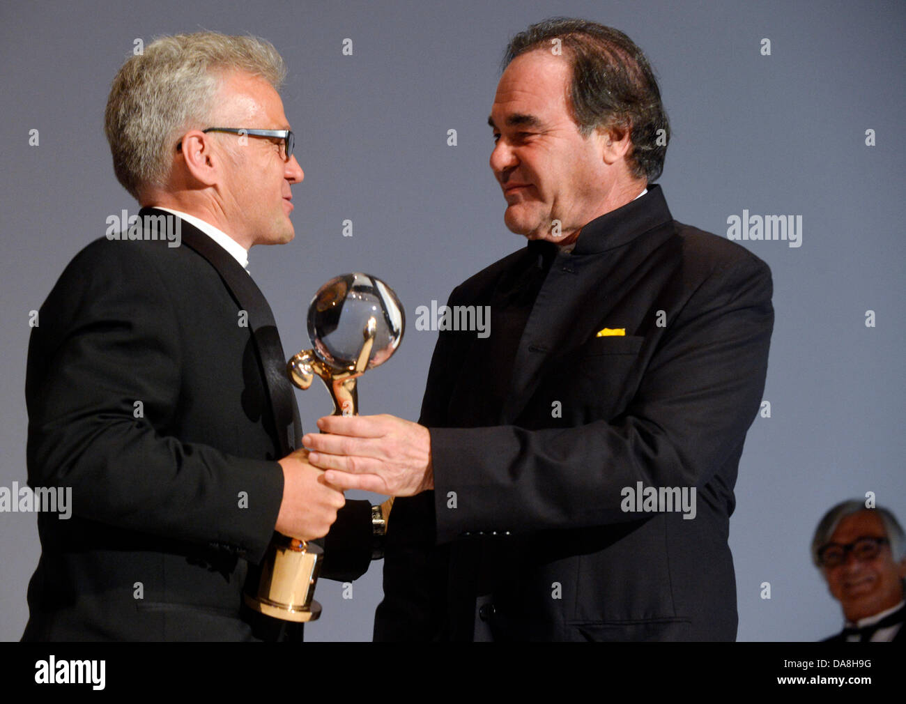 Karlovy Vary, Czech Republic. 6th July, 2013. Producer Sandor Soth (left) took over the Crystal Globe award for - Stock Image