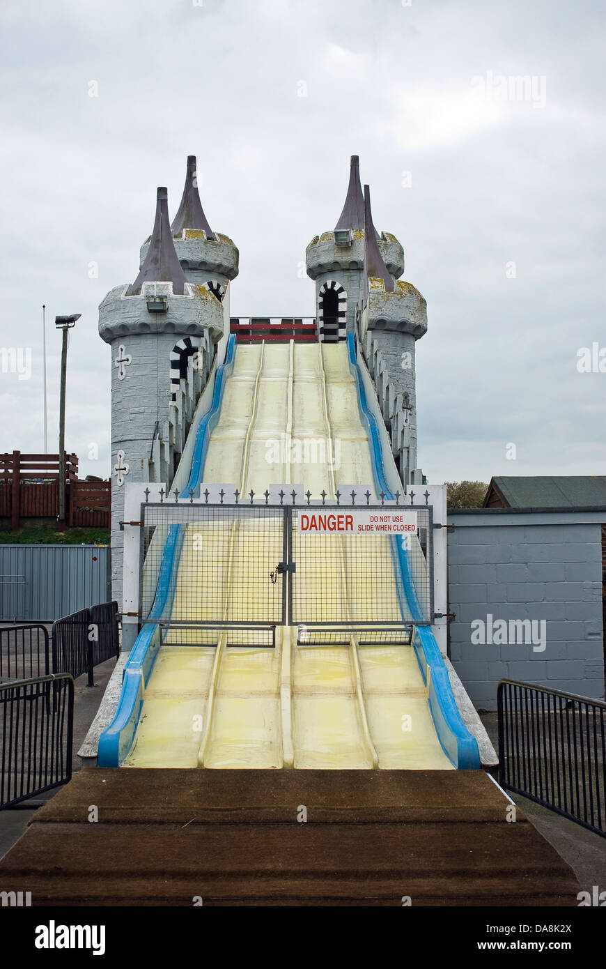 Closed down, deserted funfair rides out of season on Littlehampton Seafront, West Sussex, UK - Stock Image
