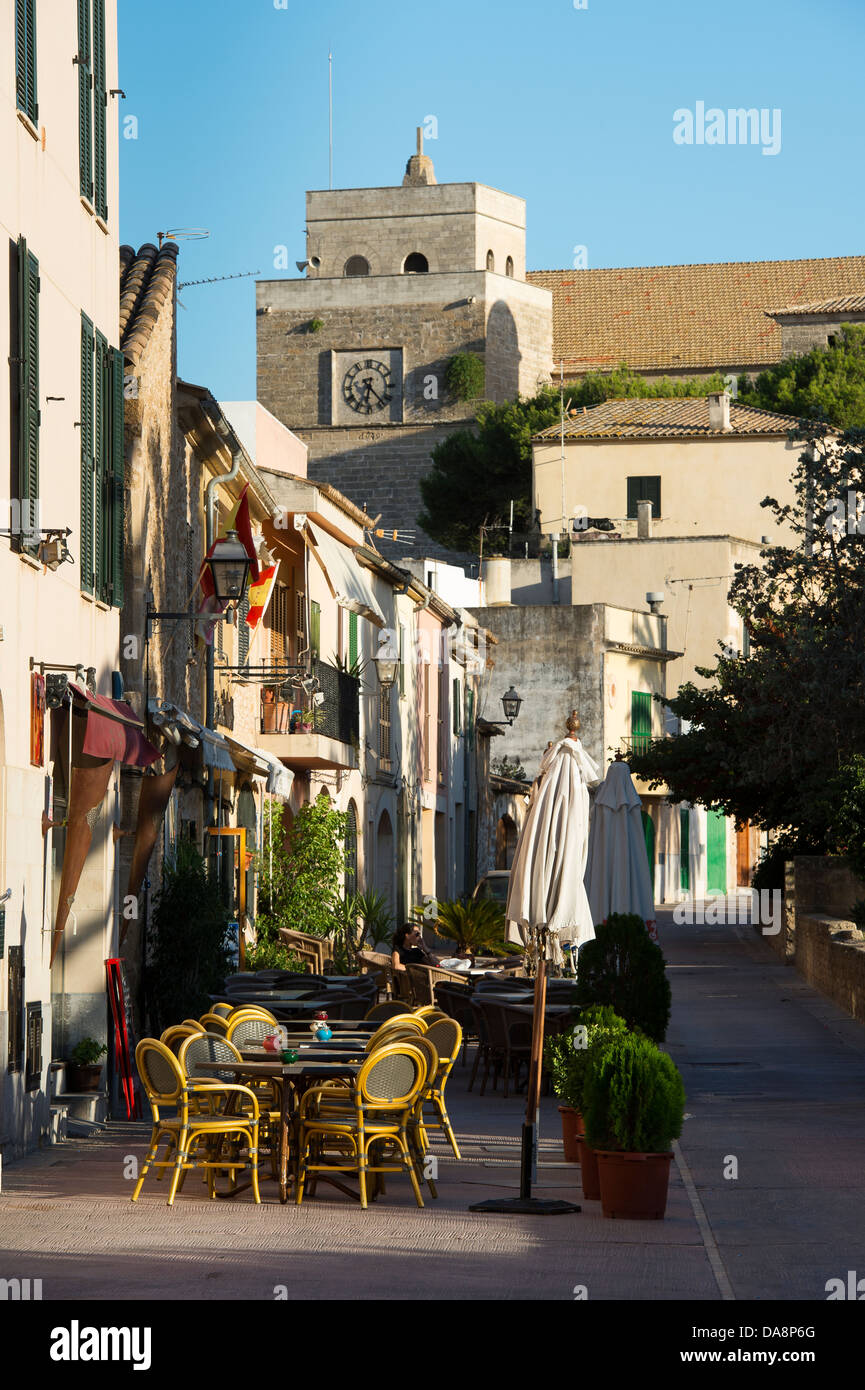 Empty tables and chairs outside a bar in the Old Town area of Alcudia, Mallorca - Stock Image
