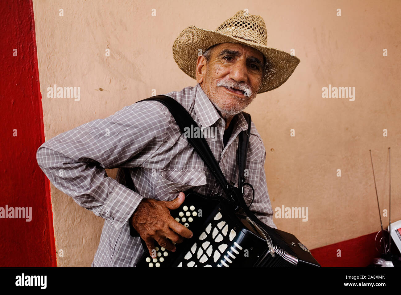 An accordion player in Monterrey Mexico. - Stock Image