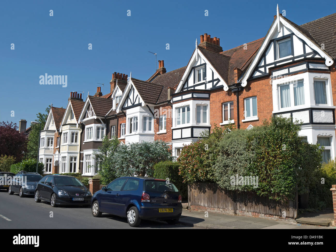 terrace of victorian houses with bay windows in teddington, middlesex, england - Stock Image