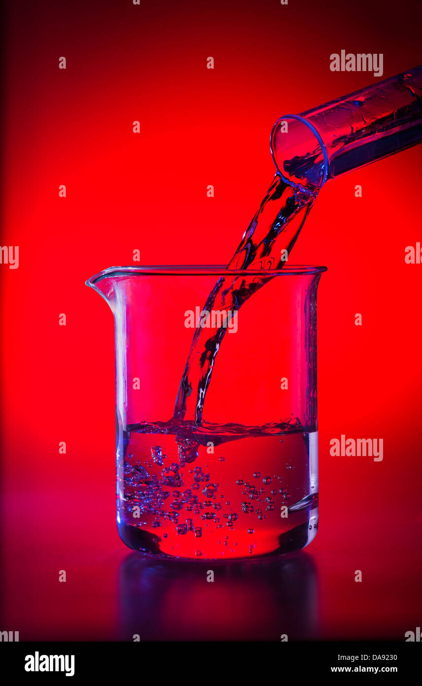 Glass Beaker In Lab Pouring Liquid Chemicals Into Beakers Stock Photo