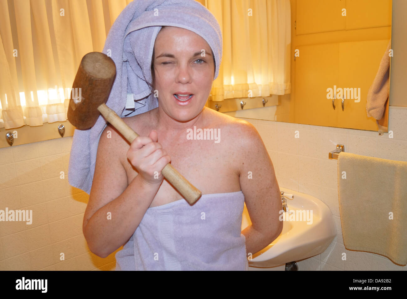 Woman remodeling her bathroom. - Stock Image