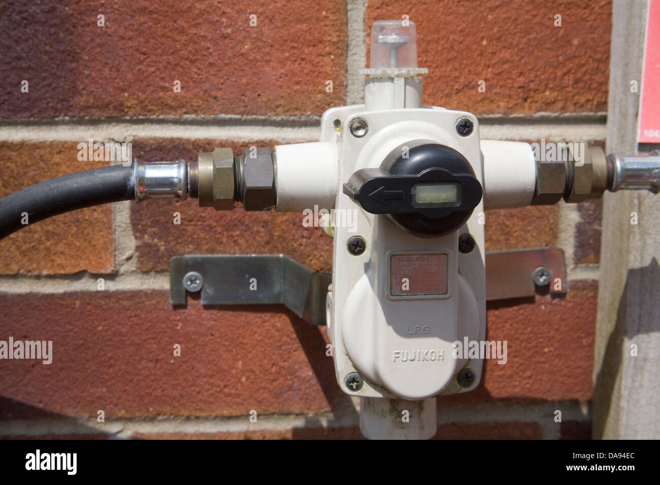 Close up Calor Gar regulator and two hose tails to Propane Gas Bottles - Stock Image