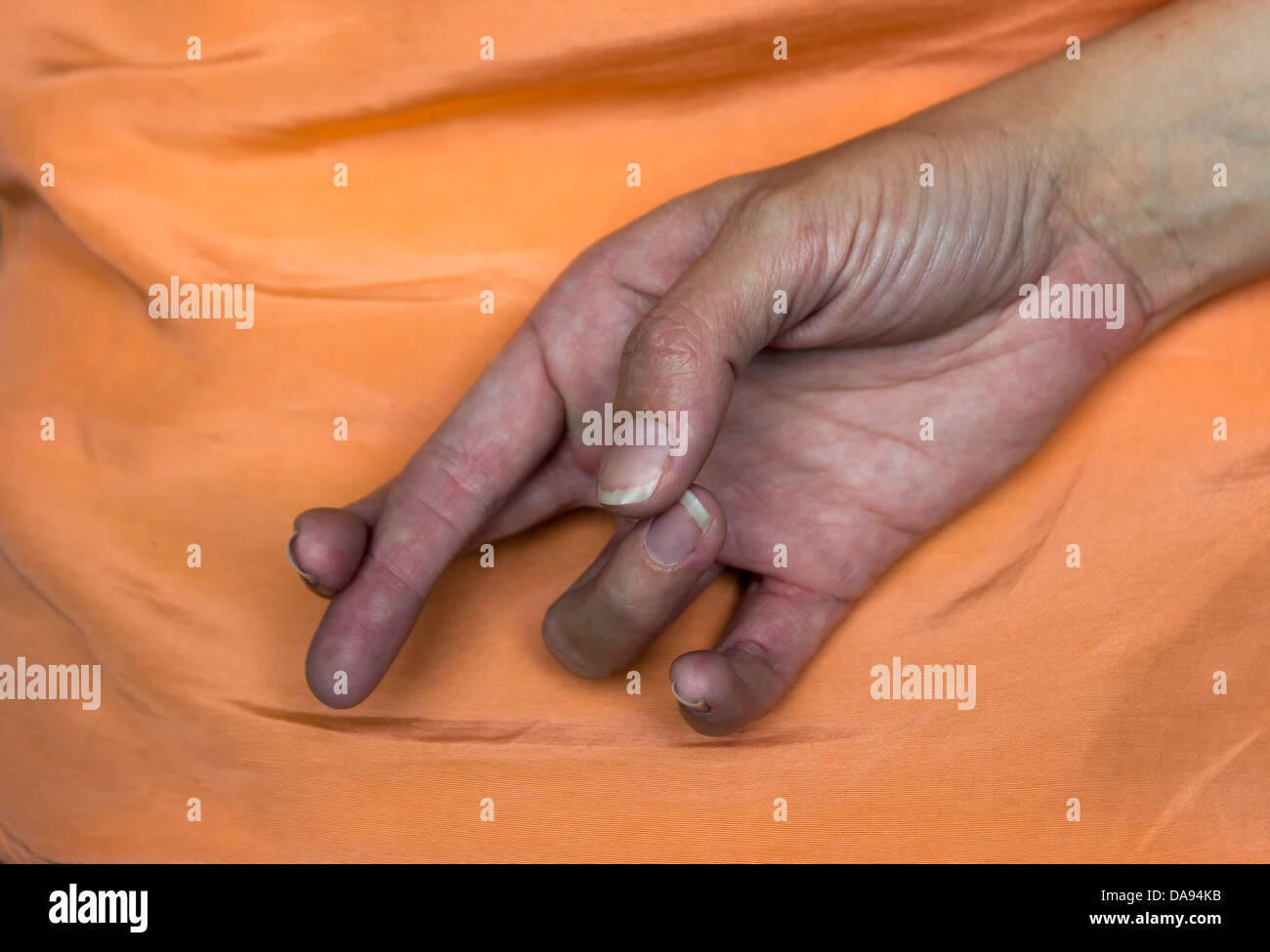 Keep your fingers crossed. - Stock Image