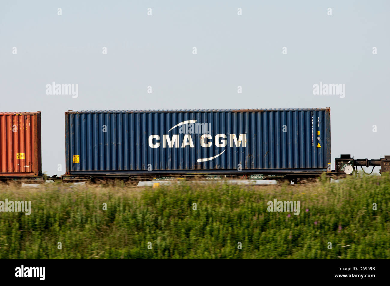CMA CGM shipping container on a train - Stock Image
