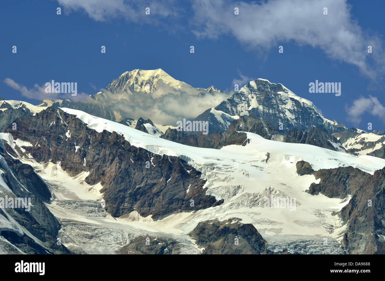 Left of centre : the Grand Combin, Right Mont Colon and the Pigne d'Arolla. In the foreground the Tete Blanche - Stock Image