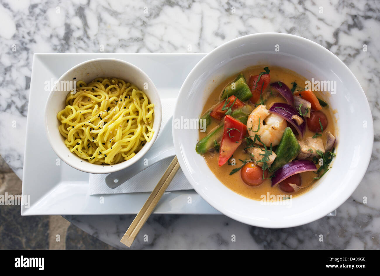 Prawn Thai Green Curry with egg noodles. - Stock Image