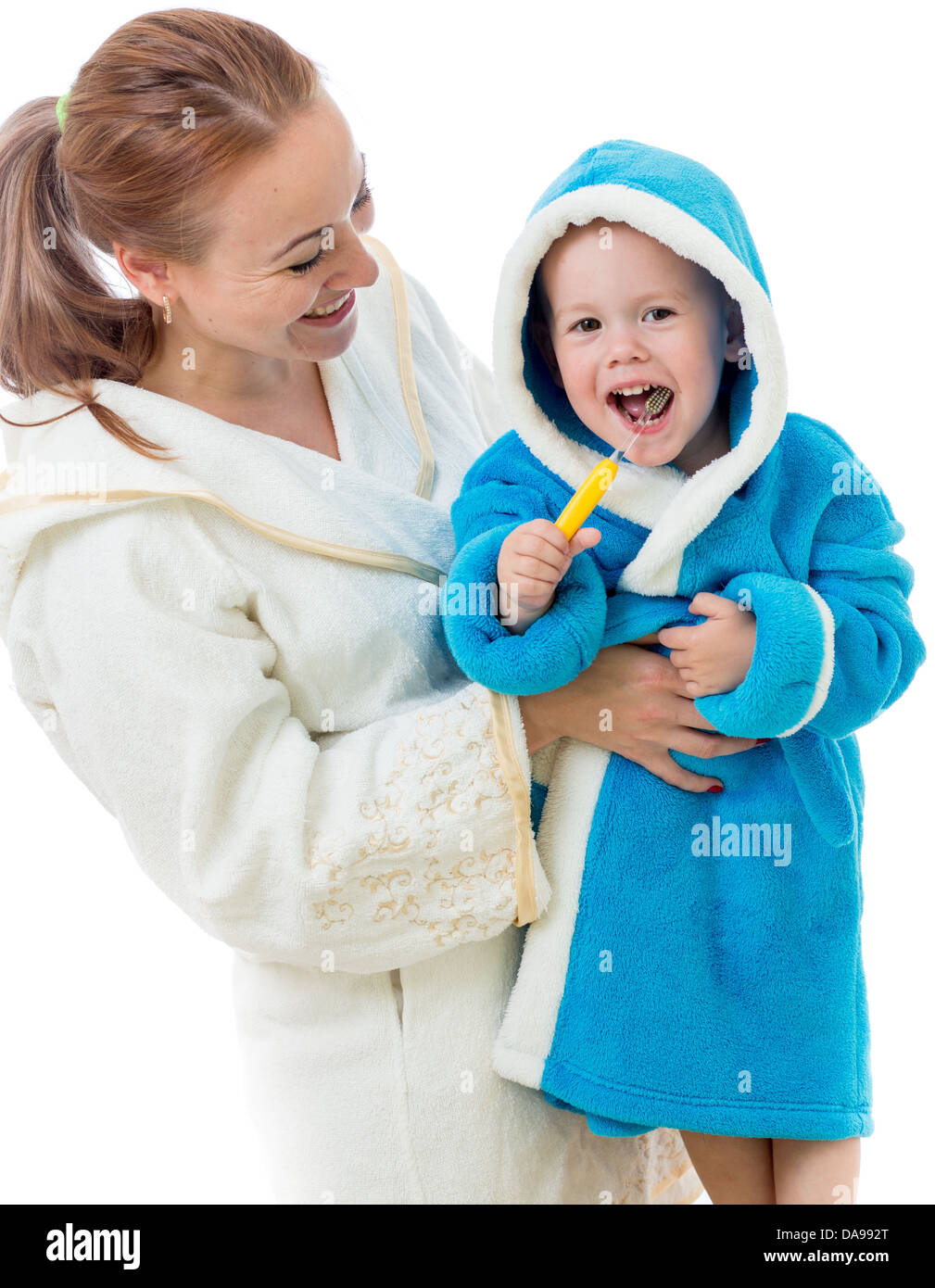 Happy mother and child teeth brushing together in bathroom Stock Photo