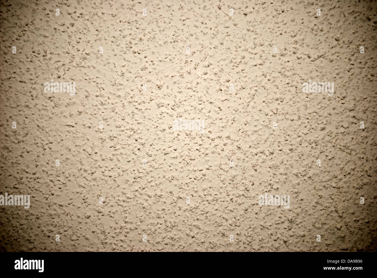 Beige grained wall background or texture - Stock Image