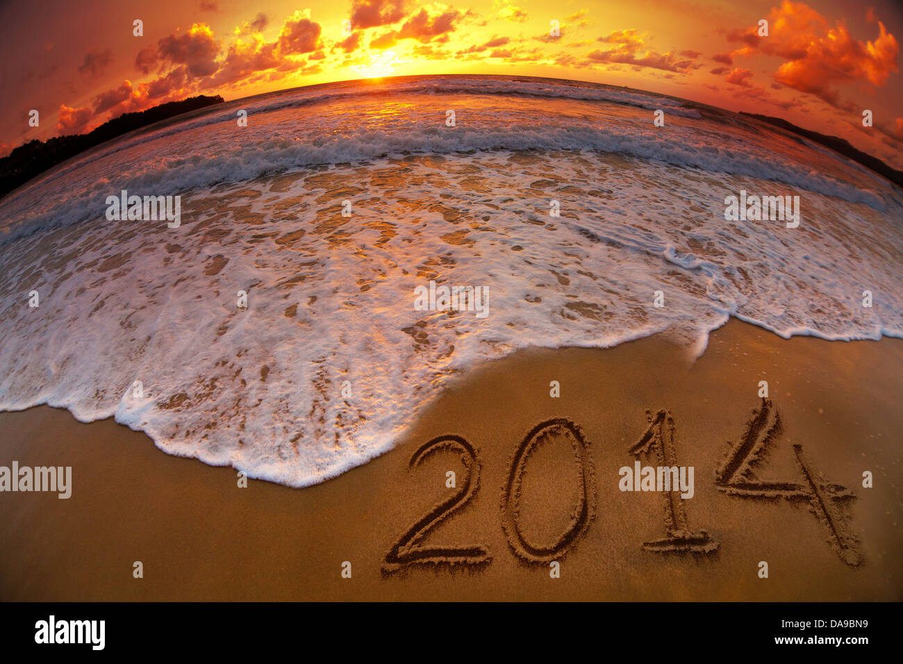 new year 2014 digits on ocean beach sunset - Stock Image