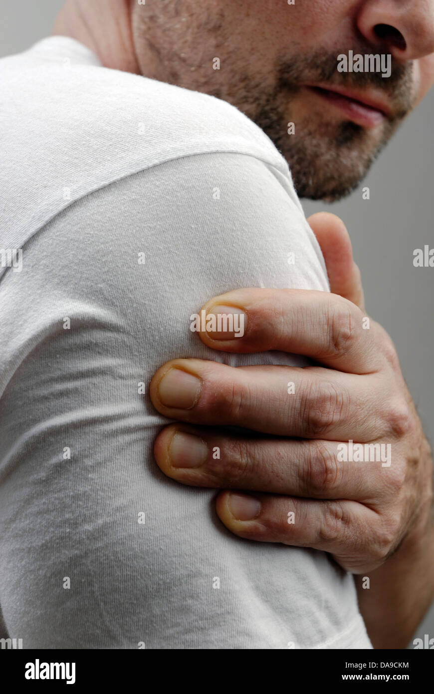 Pain in the upper arm - Stock Image