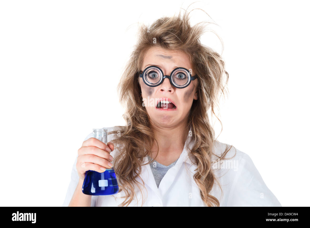 Crazy chemist woman with disheveled hair and vial in hands - Stock Image