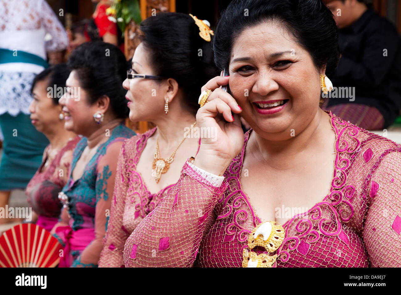 Balinese Woman With Cell Phone Stock Photos & Balinese Woman With ...