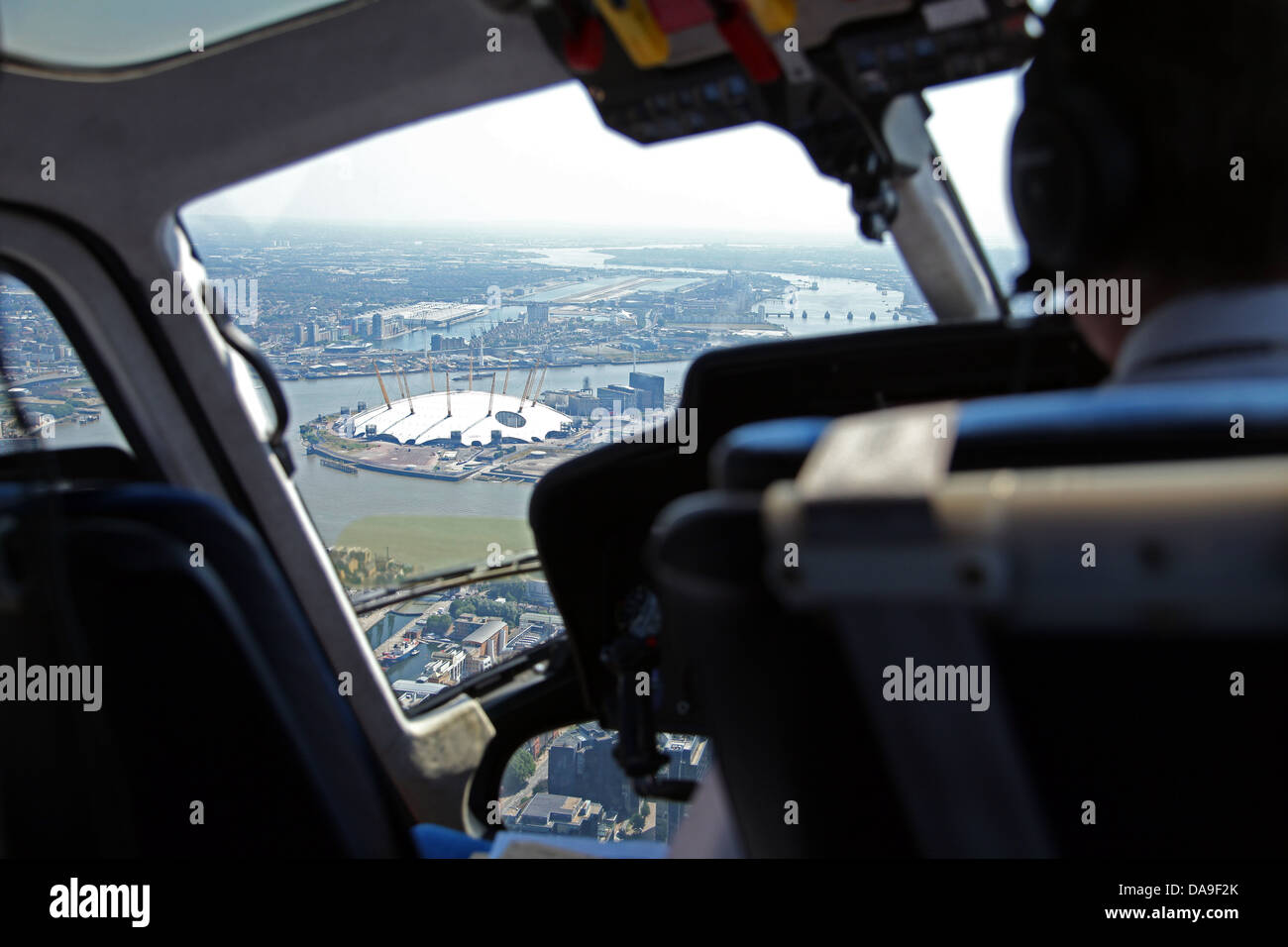 aerial view of The Thames and O2 Arena in London through a helicopter window - Stock Image