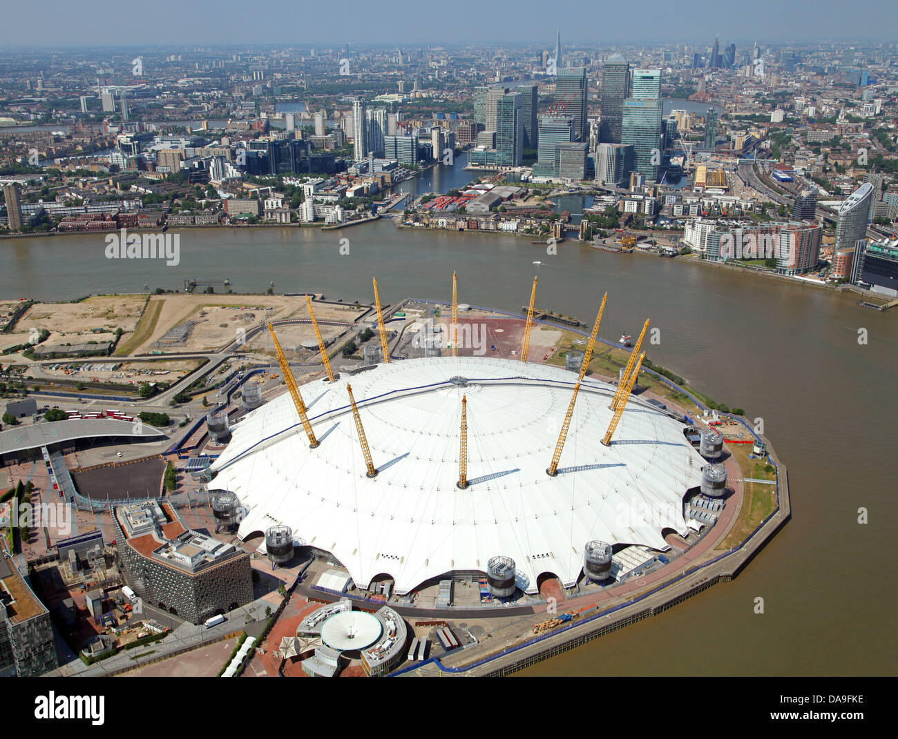 aerial view of the O2 Arena, Millennium Dome, London with Canary Wharf in the background - Stock Image