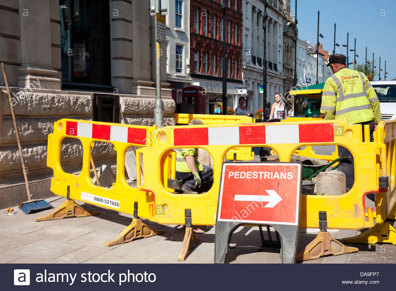 Work men digging up the pavement in Hereford, UK. - Stock Image