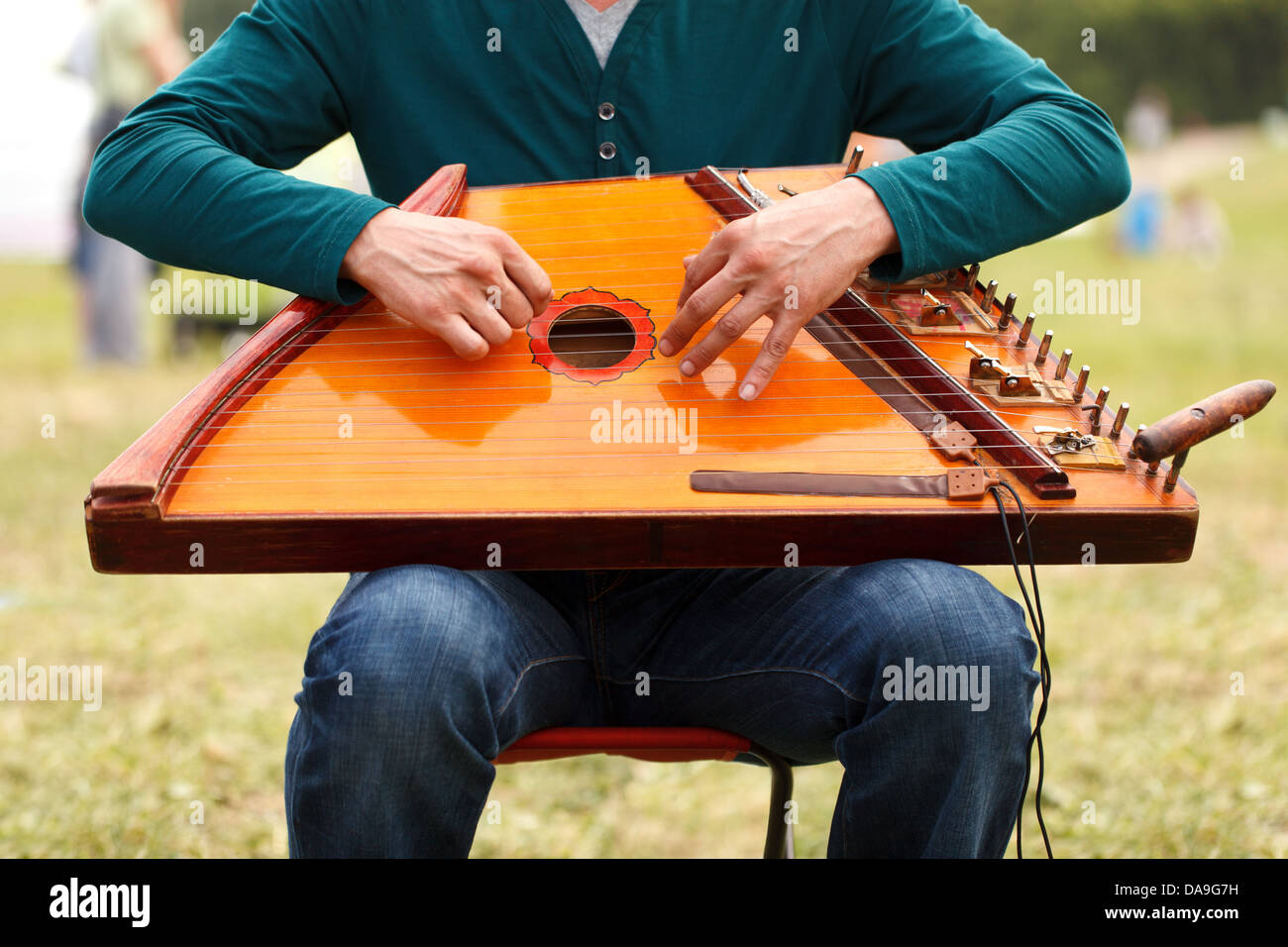 Folk musician playing gusli Stock Photo