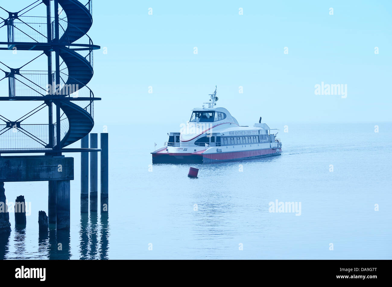 Catamaran Constance comes in, harbour of Friedrichshafen at Lake Constance, Germany. - Stock Image