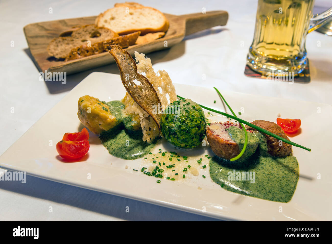 Knödel or Canederli bread dumplings, a typical speciality of Alto Adige or South Tyrol, Italy - Stock Image
