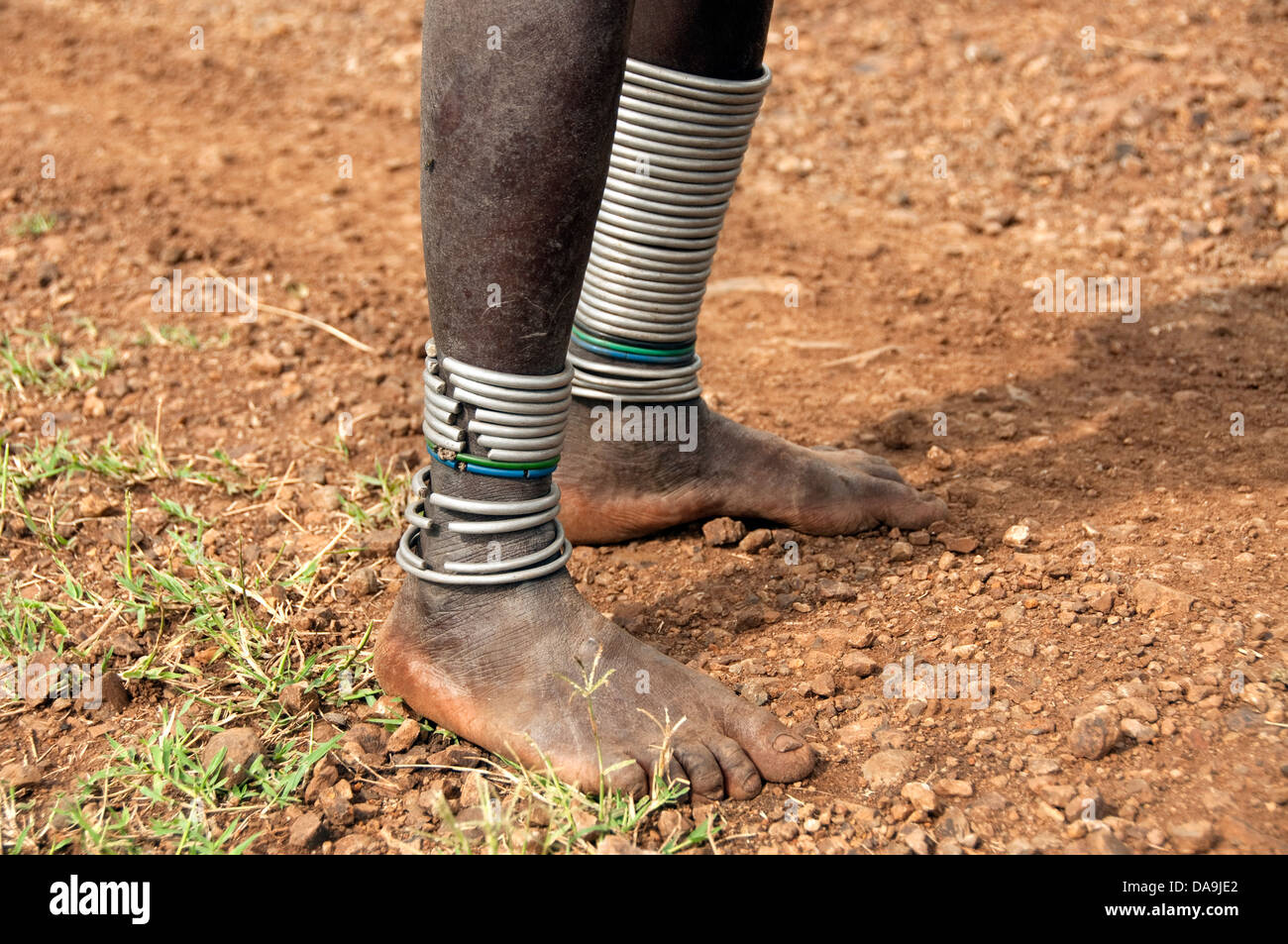 Legs of a Suri (Surma) woman with meal bracelets, Ethiopia - Stock Image