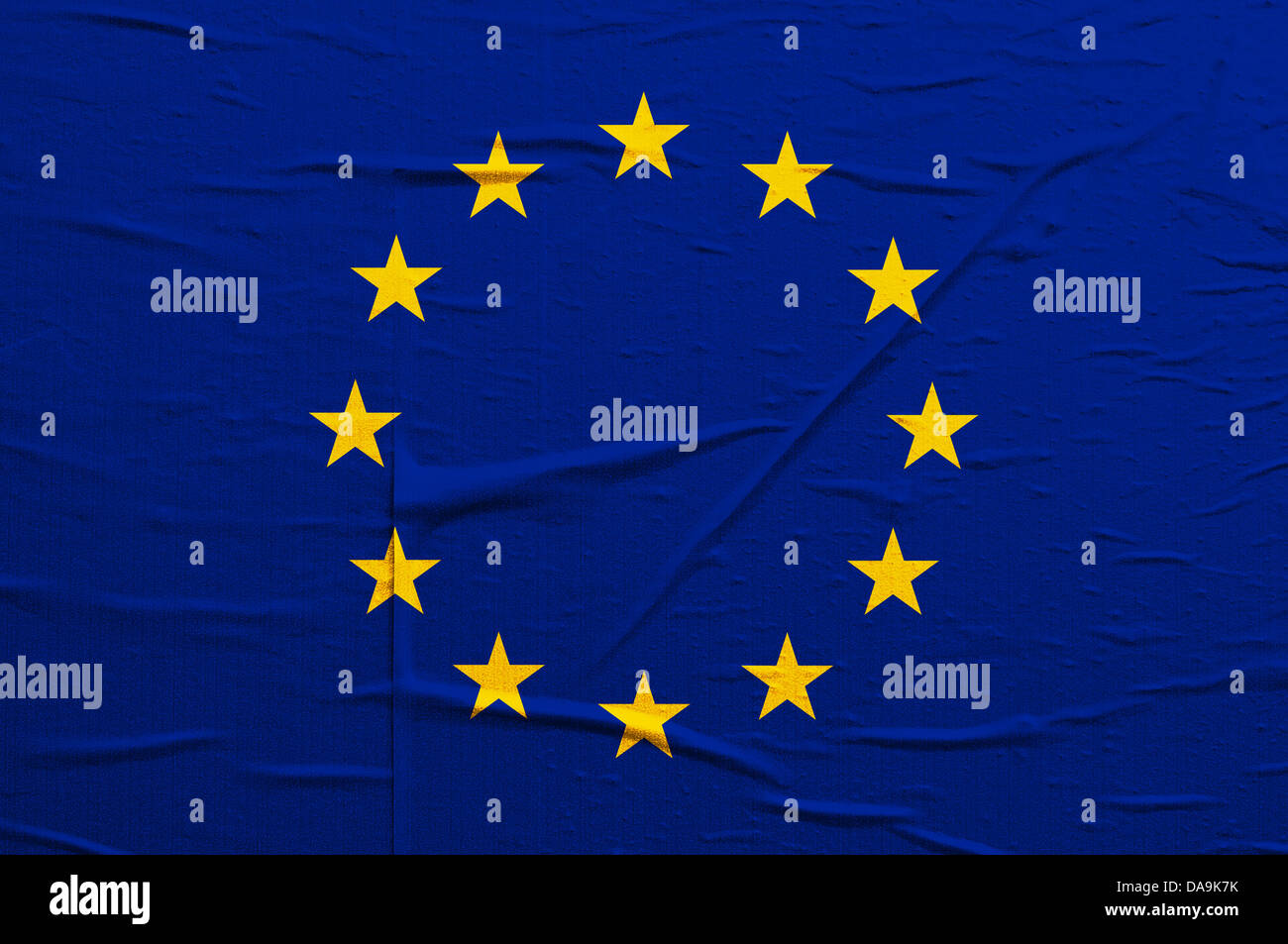 Grunge blue European Union flag with yellow stars overlaying a grungy texture - Stock Image