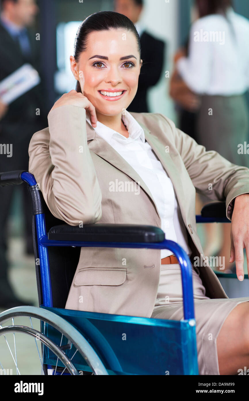 optimistic handicapped young woman in modern business world - Stock Image