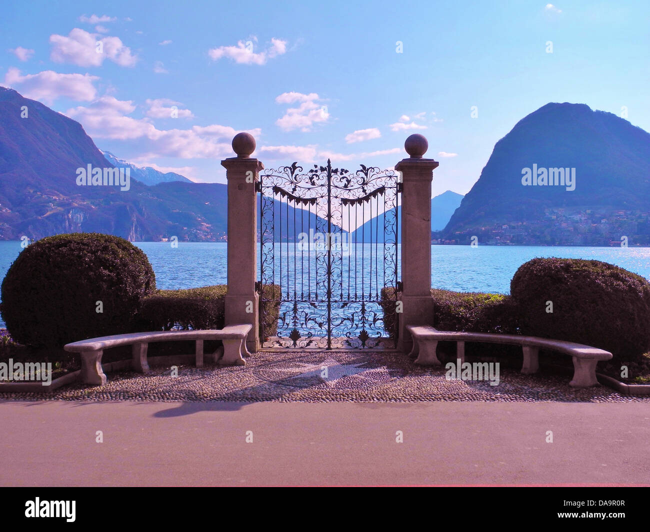 Switzerland, Ticino, Lugano, lake, Lake Lugano, bank way, gate, iron, columns, mountains, scenery - Stock Image